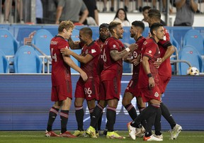 Toronto FC players celebrate Jacob Shaffelburg's goal in the 18th minute against Nashville SC at BMO Field on Saturday night.