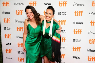 Director Danis Goulet and Producer Tara Woodbury pose at the premiere of the thriller Night Raiders, at the Toronto International Film Festival, Sept. 10, 2021.