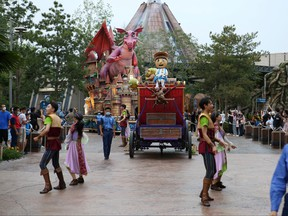 Visitors watch performers parade inside the Universal Studios Beijing theme park during an internal pressure test ahead of the Universal Beijing Resort's opening, in Beijing, Aug. 23, 2021.