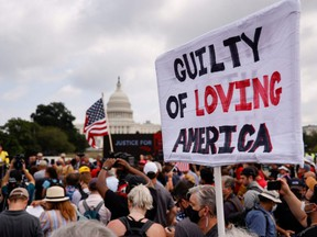 A sign is held during a rally in support of defendants being prosecuted in the Jan. 6 attack on the U.S. Capitol, in Washington, D.C., Saturday, Sept. 18, 2021.