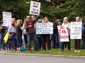 Hundreds of people came out to Foothills Hospital in Calgary to protest mandatory vaccines and vaccine passports on Wednesday, Sept. 1, 2021. Similar protests were seen in cities across the country.