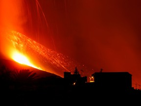 Lava and smoke rise following the eruption of a volcano on the Canary Island of La Palma, in El Paso, Spain, September 25, 2021.