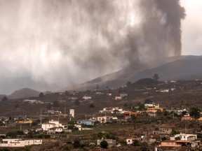 The volcano that went on erupting on Sept. 19 in Cumbre Vieja mountain range, spewes gas, ash and lava over the Aridane valley as seen from Los Llanos de Aridane on the Canary Island of La Palma, on Sept. 22, 2021.