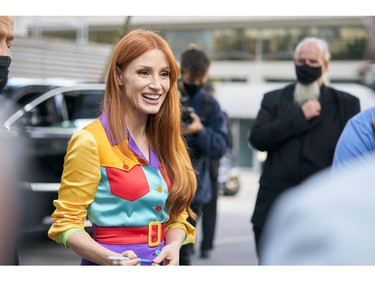Actress Jessica Chastain smiles at a fan following a press conference at Roy Thompson Hall for the Toronto International Film Festival in Toronto, Sept. 11, 2021.