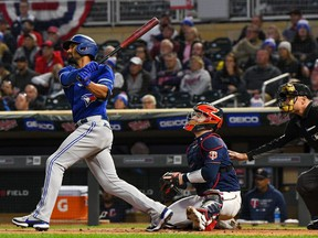 Toronto Blue Jays infielder Marcus Semien (10) hits a double off of Minnesota Twins starting pitcher Bailey Ober (82) during the first inning at Target Field.