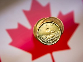 """A Canadian dollar coin, commonly known as the """"Loonie"""", is pictured in this illustration picture taken in Toronto, January 23, 2015."""
