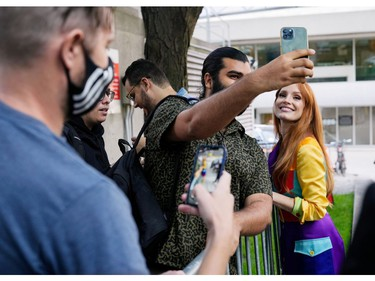 TIFF Tribute Actor Award recipient Jessica Chastain takes a selfie with a fan after a news conference for the 2021 TIFF Tribute Awards during the Toronto International Film Festival in Toronto, Sept. 11, 2021.