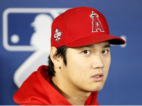 Shohei Ohtani of the Los Angeles Angels looks on before the game against the Seattle Mariners at T-Mobile Park on October 03, 2021 in Seattle, Washington.