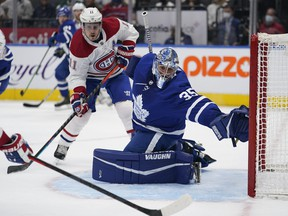 Maple Leafs goaltender Petr Mrazek defends the goal as Canadiens forward Brendan Gallagher waits for a pass during a pres-season game.