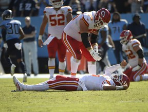 Kansas City Chiefs quarterback Patrick Mahomes takes a moment on the turf to gather his thoughts after taking a hit on a fourth-down play against the Tennessee Titans during the second half at Nissan Stadium.
