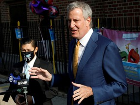 New York City Mayor Bill de Blasio speaks during a news conference after greeting students for the first day of in-person pre-school following the outbreak of the coronavirus disease (COVID-19) in the Queens borough of New York City, U.S., September 21, 2020.