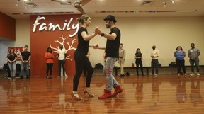 Aleksander Saiyan, director of operations at Toronto Dance Salsa studio in North York, dances with his partner Mariami as they help train his students.