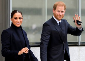 Prince Harry and Meghan, Duke and Duchess of Sussex, wave as they visit One World Trade Center in Manhattan September 23, 2021.