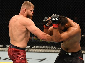 Jan Blachowicz (left) punches Dominick Reyes in their light heavyweight championship bout during UFC 253 inside Flash Forum on UFC Fight Island on September 27, 2020 in Abu Dhabi, United Arab Emirates.