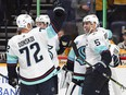 Seattle Kraken defenceman Mark Giordano (5) and forward Joonas Donskoi (72) celebrate with teammates after the first win in franchise history at Bridgestone Arena.