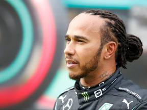 Mercedes' British driver Lewis Hamilton speaks to the press after the qualifying sessions at the Intercity Istanbul Park in Istanbul on Oct. 9, 2021, ahead of the Formula One Grand Prix of Turkey.