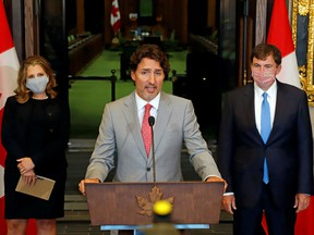 Canadian Prime Minister Justin Trudeau speaks to reporters next to Canadian Deputy Prime Minister and Finance Minister Chrystia Freeland and Minister of Intergovernmental Affairs Dominic LeBlanc on Parliament Hill in Ottawa August 18, 2020.