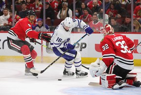 Maple Leafs' Mitch Marner tries to get off a shot against Kevin Lankinen of the Blackhawks under pressure from Seth Jones at the United Center on Wednesday, Oct. 27, 2021 in Chicago.