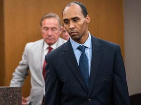 Former police office Mohamed Noor walks to the podium to be sentenced in the fatal shooting of Justine Ruszczyk Damond at the Hennepin County District Court in Minneapolis, Minnesota on June 7, 2019.