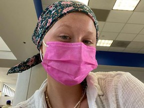 Actress Miranda McKeon wearing mask and wrap on her head.