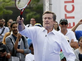 Mayor John Tory is pictured on July 21, 2016 when he faced Canadian tennis player Milos Raonic in a friendly match at Nathan Phillips Square as part of the lead up to the Rogers Cup 2016.