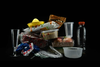 This illustration shows plastic containers, plastic cutlery and plastic-wrapped food packaging containing phthalates, a group of chemicals used by major fast-food brands in products from food-handling gloves to processing equipment, such as industrial tubing and conveyors. A new study says these leach into the food we order at restaurants.