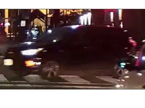 A dark-coloured SUV involved in a hit and run in downtown Toronto on Friday evening