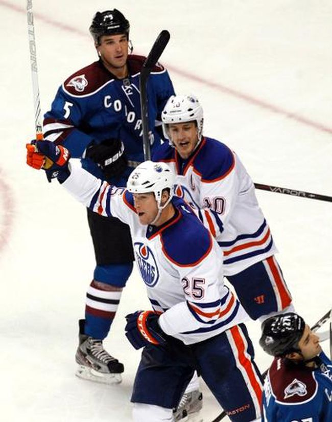 Oilers defenceman Andy Sutton and captain Shawn Horcoff celebrate Sutton's first goal of the season during the second period against the Avalanche Friday at the Pepsi Center in Denver, Colo. (Rick Wilking, Reuters)