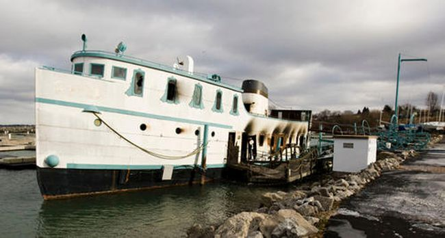 The St. Catharines Fire dept. was still scene Wednesday afternoon after fire broke out on Toyko Joe's floating restaurant in Port Dalhousie.  Dec 28th 2011 BOB TYMCZYSZYN/ST. CATHARINES STANDARD/QMI AGENCY