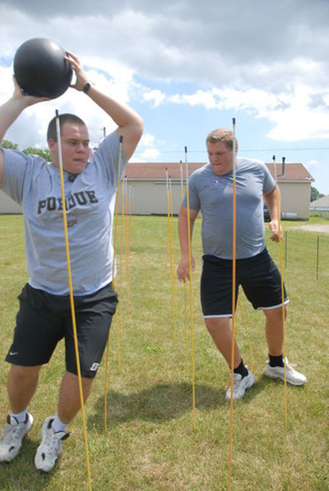 aJACOB ROBINSON Times-ReformerHenry Lorenzen (left) and Shane Bergman run through one of the off-season training drills the pair have been using at Steve BozsoÕs Speed and Quickness Training Facility in preparation for their upcoming football seasons at Purdue University and Western University respectively.