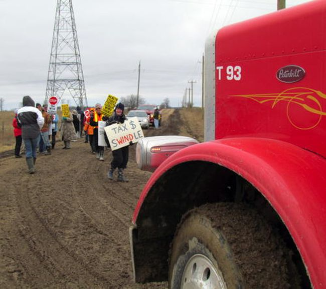 Protesters outside Zephyr Wind Farms Tuesday.