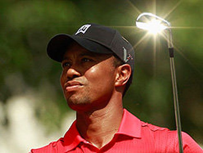 Tiger Woods watches his shot from the seventh tee during the final round of the AT&T National at Congressional Country Club in Bethesda, Md., July 1, 2012. (KEVIN LAMARQUE/Reuters)