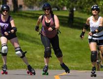 Ashley Rammeloo, left, Rhonda Hall-Couch and Adrienne Taylor of the roller derby team Violet Femmes get some workout time on the pathway in Greenway Park. They participate in the Loco Roller Derby league. Loco stands for lower contact, lower commitment and lower cost. (MIKE HENSEN, The London Free Press)
