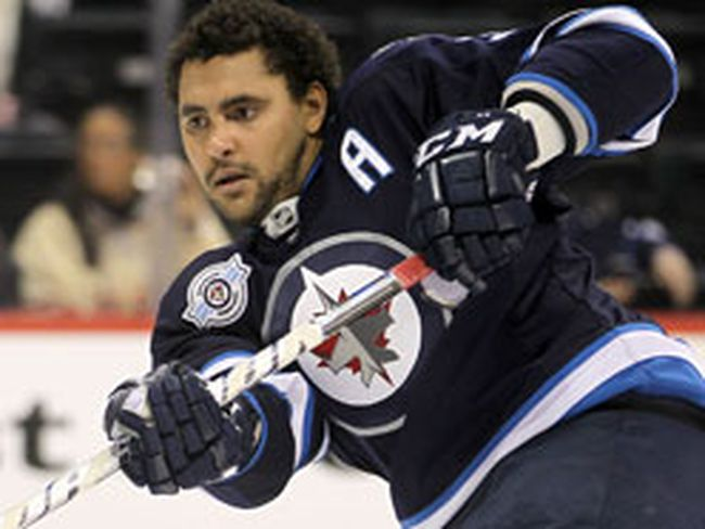 Winnipeg Jets defenceman Dustin Byfuglien fires a shot on net prior to playing the Montreal Canadiens in NHL hockey in Winnipeg Dec. 22, 2011. (BRIAN DONOGH/QMI Agency)
