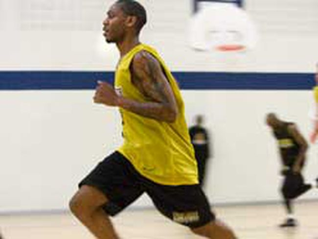 Tim Ellis runs during London Lightning practice at the Downtown Y on Tuesday. As a member of the Lightning, Ellis now has a coach -- in Michael Ray Richardson -- who gives instructions in English. (DEREK RUTTAN, The London Free Press)
