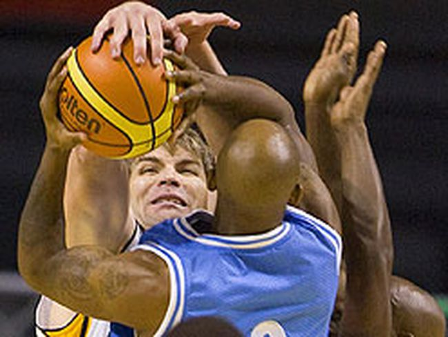 Michael King of London Lightning cleanly stuffs Taliek Brown of the Halifax Rainmen during the first half of their home opener Thursday night at the John Labatt Centre. (MIKE HENSEN, The London Free Press)