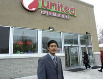 Qing Qing Lin stands outside the United Supermarket which is now open on Adelaide. SUE REEVE/THE LONDON FREE PRESS/QMI AGENCY