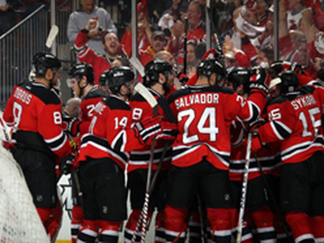 The New Jersey Devils celebrate after defeating the Philadelphia Flyers in overtime of Game 3 of the Eastern Conference semifinals in Newark, New Jersey. (Bruce Bennett/Getty Images/AFP)