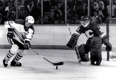 Battle of Alberta NHL playoffs. The Edmonton Oilers vs the Calgary Flames, 1984. The Edmonton Oilers #99 Wayne Gretzky moves in on Calgary Flames goalie #31 Reggie Lemelin on April, 18, 1984 at Northlands Coliseum in Edmonton during the NHL playoffs. (EDMONTON SUN FILE)