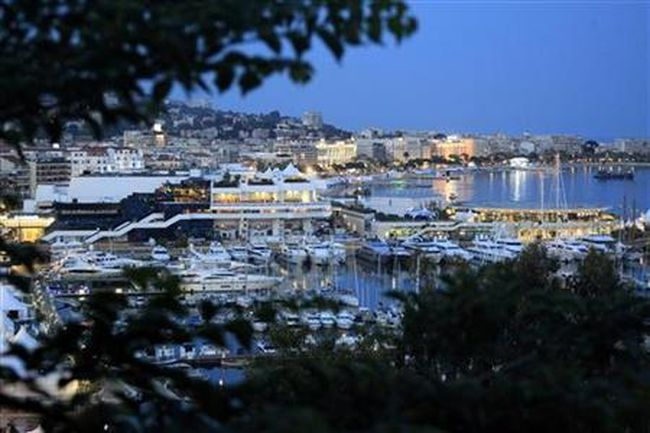 A general view shows the Festival Palace and boats moored in the harbour of Cannes, before the start of the 64th Cannes Film Festival in Cannes, May 9, 2011. (Reuters/Jean-Paul Pelissier)