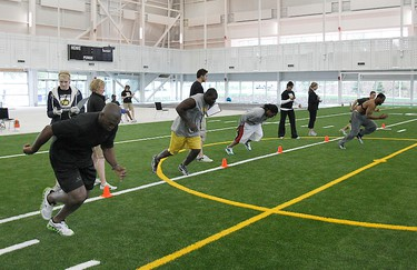 A group of players perform a drill during Edmonton Eskimos medicals and fitness testing at Commonwealth Stadium in Edmonton, Alta. on Saturday June 4, 2011. (PERRY NELSON/EDMONTON SUN)