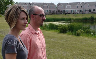 Tiffany Barrett and her fiancé Jeff Eyamie stand in Willowlake Park in south Winnipeg on Wednesday, July 20, 2011, where several Canada geese were run over by a car the previous day. Three goslings were killed. (Jillian Austin, Winnipeg Sun)