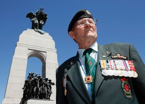 Bill Black, president of the Korean Veterans Association, National Capital Region, is photographed in front of the National War Memorial after a ceremony paying tribute to Korean War Veterans Sunday. (DARREN BROWN/QMI AGENCY
