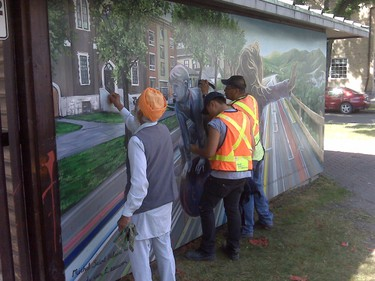 BIZ crews began removing the paint Tuesday, and with the help of local residents the cleanup was going extremely well, BIZ executive director Gloria Cardwell-Hoeppner said. (HANDOUT)