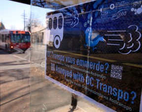 """A sign saying """"Annoyed with OC Transpo?"""" with the mayor's Twitter address was posted at a bus shelter on Smyth Rd. Tuesday  Tony Caldwell/Ottawa Sun"""