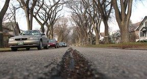 A road in need of repair in River Heights.