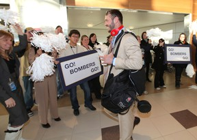 Winnipeg Blue Bombers fans and airport staff cheer as QB Buck Pierce prepared to leave Winnipeg Richardson International Airport to play in the CFL Grey Cup in Vancouver. (JASON HALSTEAD, Winnipeg Sun)