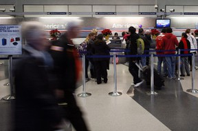 Passengers walk through American Airlines terminal 3 at O'Hare International in Chicago, December 23, 2011. REUTERS/Frank Polich