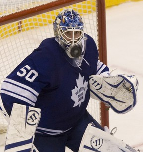 Leafs' goalie Jonas Gustavsson keeps his eye on the floating puck during Toronto's Dec. 17 loss at home to the Canucks. (Jack Boland / Toronto Sun)
