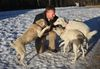 Spencer Sekyer plays with some of the dogs he help rescue from Kabul. (Perry Mah/QMI Agency)